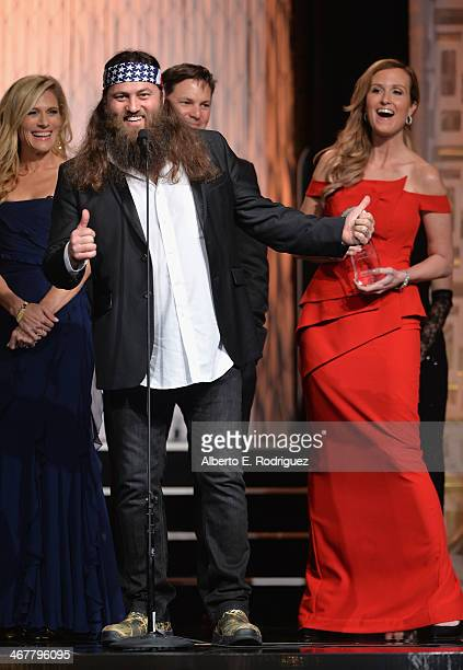 TV personalities Willie Robertson and Korie Robertson speak on stage at the 22nd Annual Movieguide Awards Gala at the Universal Hilton Hotel on...