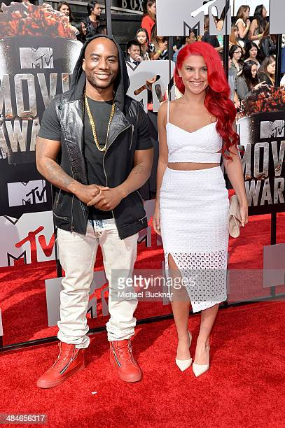 TV personalitites Charlamagne Tha God and Carly Aquilino attend the 2014 MTV Movie Awards at Nokia Theatre LA Live on April 13 2014 in Los Angeles...