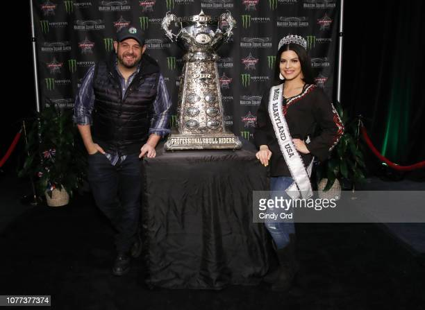 TV personality Adam Richman and Miss Maryland USA 2019 Mariela Pepin attend the 2019 Professional Bull Riders Monster Energy Buck Off at the Garden...