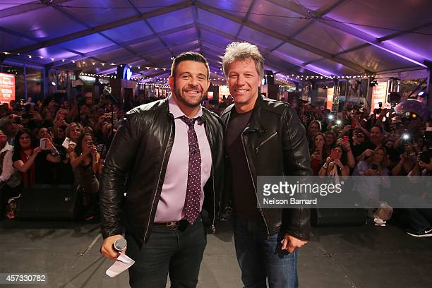 TV personality Adam Richman and musician Jon Bon Jovi appear on stage at Ronzoni's La Sagra Slices hosted by Bongiovi Brand pasta sauces Adam Richman...