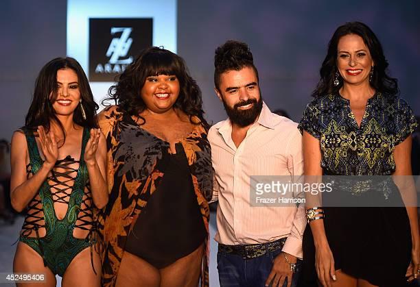 TV personality Adriana De Moura Brazilian actress Priscilla Marinho designer AZ Araujo and model/business woman Cozete Gomes walk the runway at the...