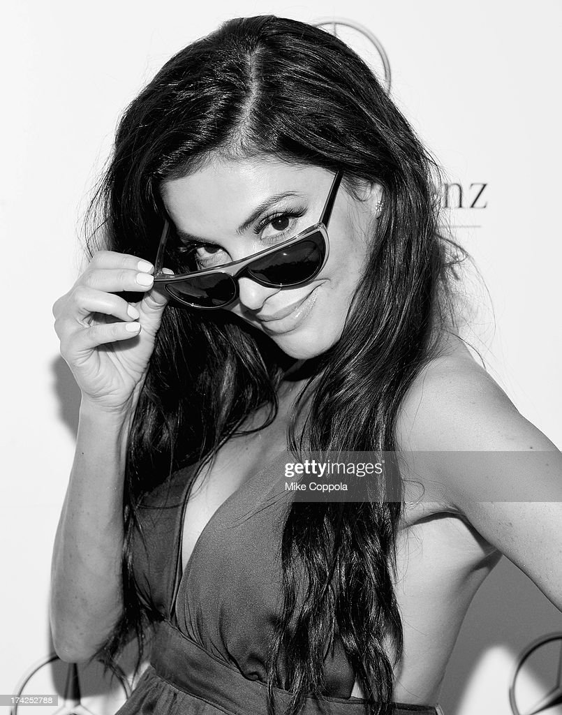 TV personality Adriana de Moura seen during Mercedes-Benz Fashion Week Swim 2014 at the Raleigh Hotel on July 21, 2013 in Miami Beach, Florida.