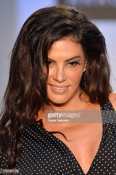TV personality Adriana De Moura walks the runway at the AZ Araujo show during MercedesBenz Fashion Week Swim 2014 at Oasis at the Raleigh on July 21...
