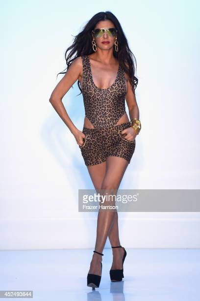 TV personality Adriana De Moura walks the runway at the AZ Araujo show during MercedesBenz Fashion Week Swim 2015 at The Raleigh on July 21 2014 in...
