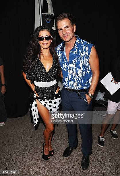 Personality Adriana DeMoura and actor Vincent De Paul pose backstage at the AZ Araujo show during MercedesBenz Fashion Week Swim 2014 at Oasis at the...