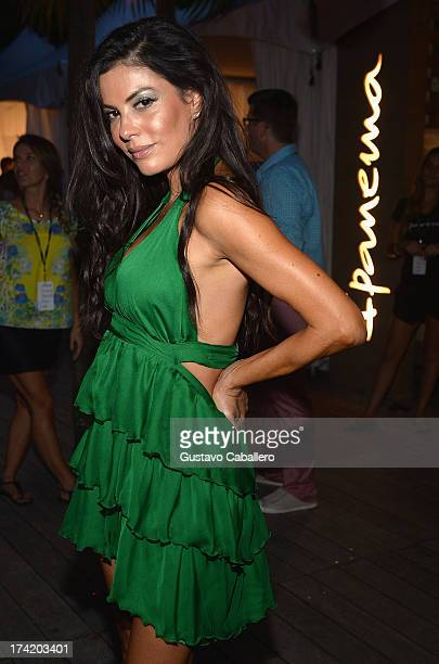 Personality Adriana DeMoura poses backstage with Ipanema at the L*SPACE By Monica Wise show during MercedesBenz Fashion Week Swim 2014 at Cabana...