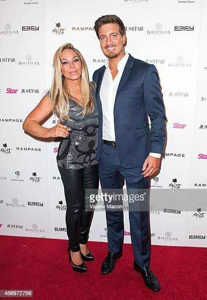 TV personality Adrienne Maloof and Jacob Busch attend the Star Magazine's Scene Stealers Event at Lure on October 9 2014 in Los Angeles California