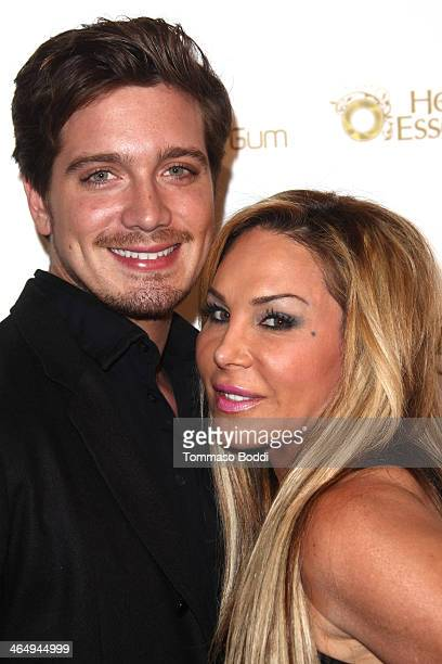 TV personality Adrienne Maloof and Jacob Busch attends the OK Magazine preGrammy party held at Lure on January 24 2014 in Hollywood California