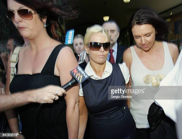 TV personality Ajay Rochester leaves court with friends and family members having faced welfare fraud charges at Downing Centre Local Court on...