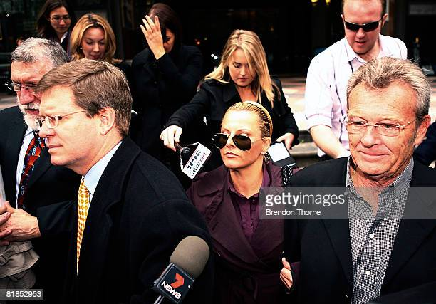TV personality Ajay Rochester leaves court with her lawyer Geoffrey Meadows having faced welfare fraud charges at Downing Centre Local Court on July...