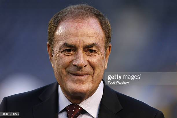 TV personality Al Michaels stands on the field before a game between the New England Patriots and the San Diego Chargers at Qualcomm Stadium on...