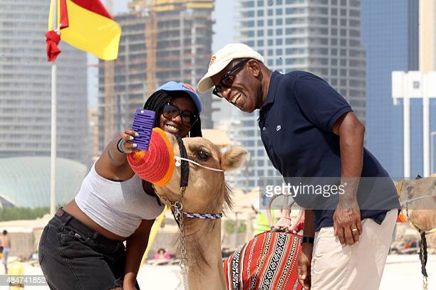 US TV personality Al Roker and his daughter Leila take a picture with a camel on the corniche in Abu Dhabi during a live broadcast of NBC's talk show...