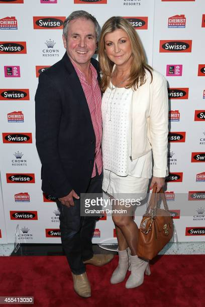 TV personality Alan Fletcher and Jennifer Hansen pose on the red carpet prior to the Robbie Williams performance at the Palms at Crown on September...