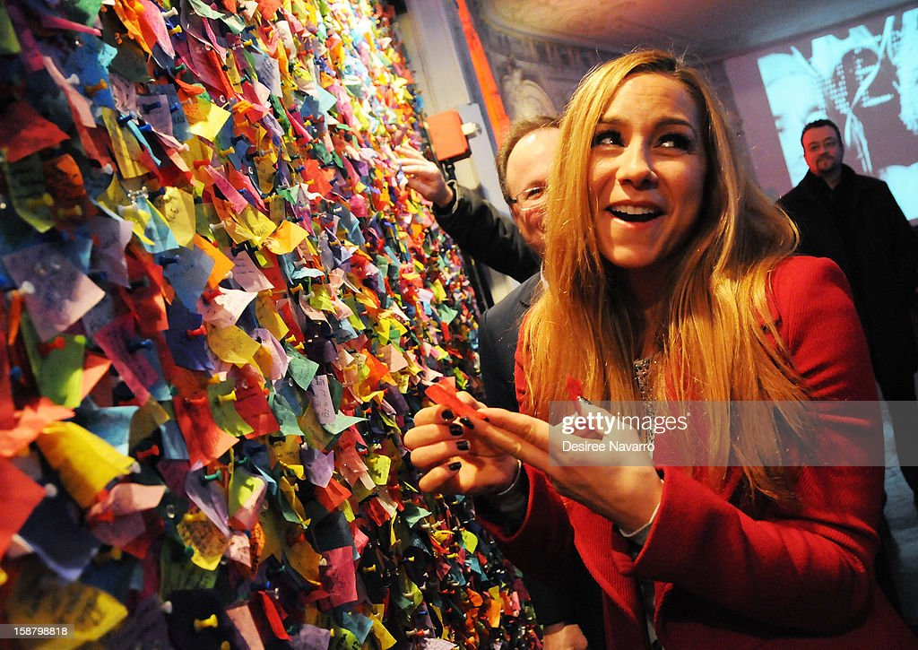TV Personality Allison Hagendorf reads wishes on the Wishing Wall at the New Year's Eve 2013 Confetti Airworthiness Test at Times Square Alliance Building on December 29, 2012 in New York City.