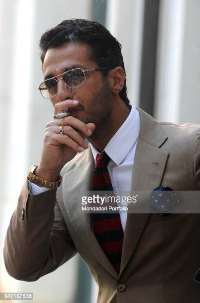 Personality and entrepreneur Fabrizio Corona smoking a cigarette in court during his trial. Milan, Italy. 2nd December 2010