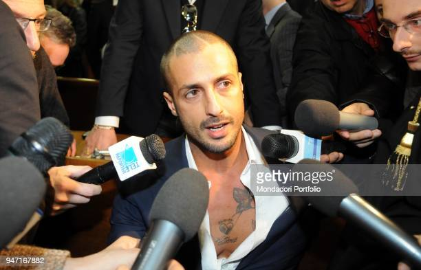 Personality and entrepreneur Fabrizio Corona surrounded by journalists in court during his trial. Milan, Italy. 10th December 2009