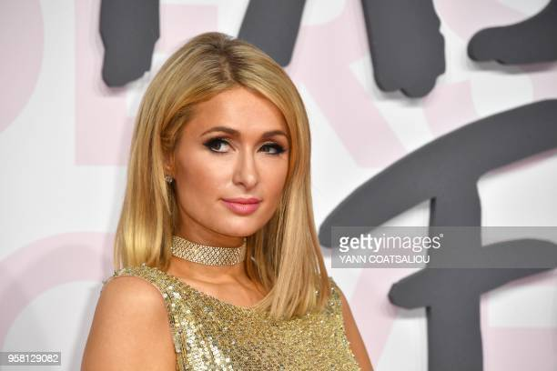 US personality and entrepreneur Paris Hilton poses as she arrives on May 13 2018 for the Fashion For Relief Cannes 2018 event on the sidelines of the...