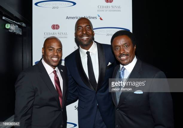 TV personality and show host Kevin Frazier retired NBA player and radio host John Salley and sportscaster Jim Hill attend the 28th Anniversary Sports...