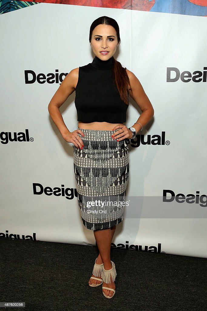 T.V. personality Andi Dorfman poses backstage at the Desigual fashion show during Spring 2016 New York Fashion Week: The Shows at The Arc, Skylight at Moynihan Station on September 10, 2015 in New York City.