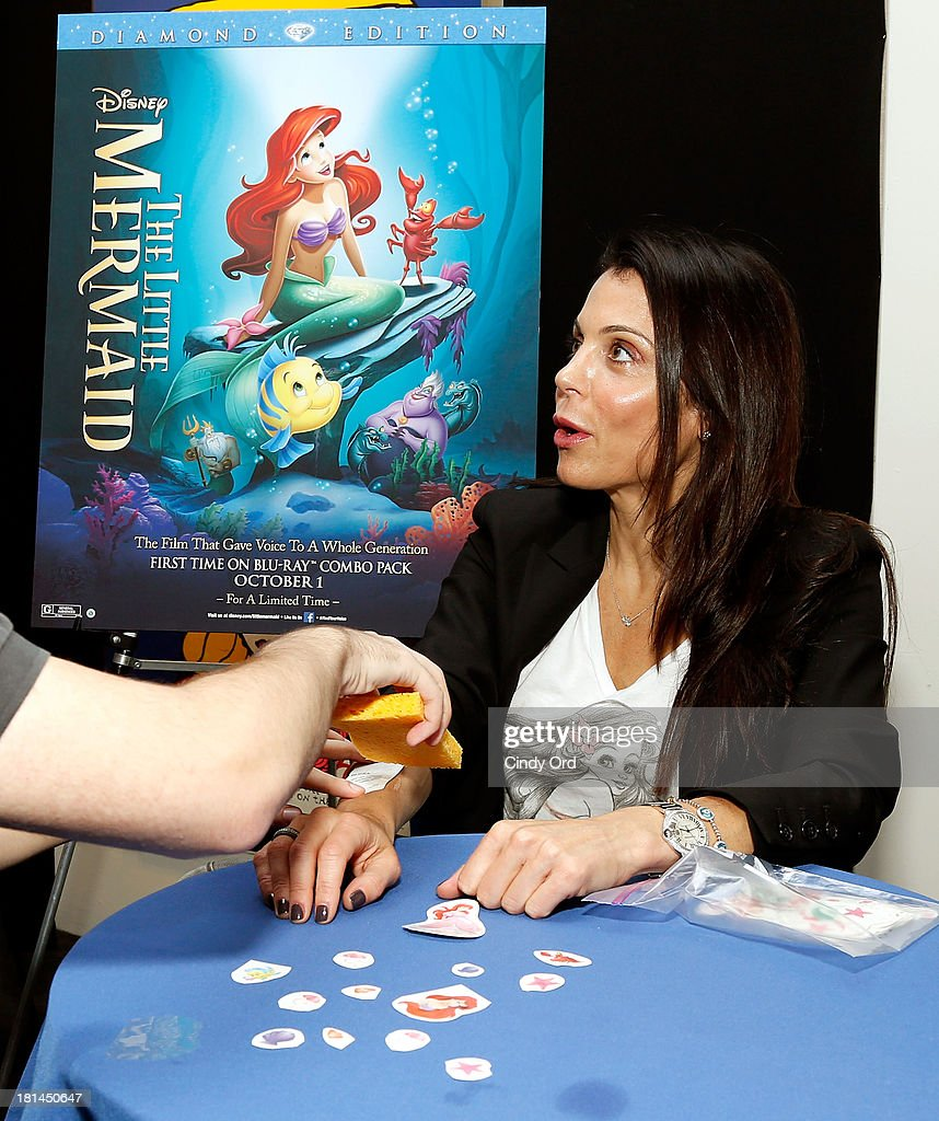 TV Personality Bethenny Frankel gets a temporary tattoo of The Little Mermaid during Disney's The Little Mermaid special screening at Walter Reade Theater on September 21, 2013 in New York City.