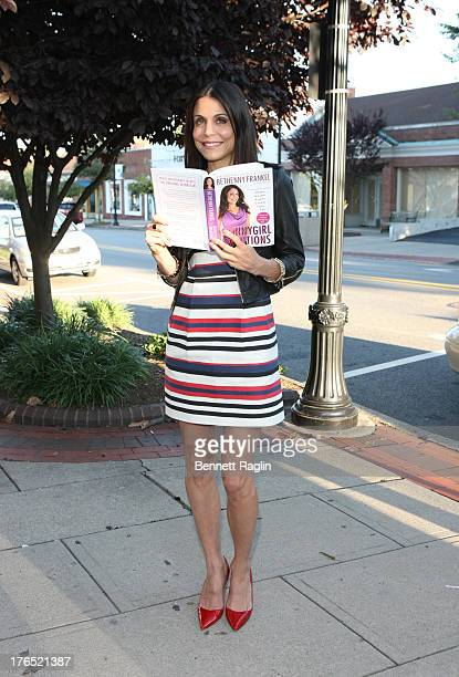 TV personality Bethenny Frankel poses for a picture while signing copies of her book 'Skinnygirl Solutions' at Bookends on August 14 2013 in...