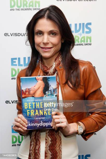 TV personality Bethenny Frankel poses with her novel 'Skinnydipping' prior to visiting the Z100 Elvis Duran Morning Show at Z100 Studio on May 9 2012...