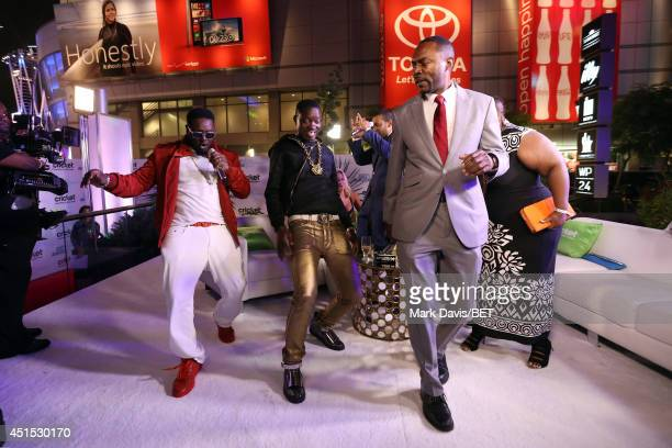 TV personality Big Tigger interviews guests during the BET AWARDS '14 post show at Nokia Theatre LA LIVE on June 29 2014 in Los Angeles California