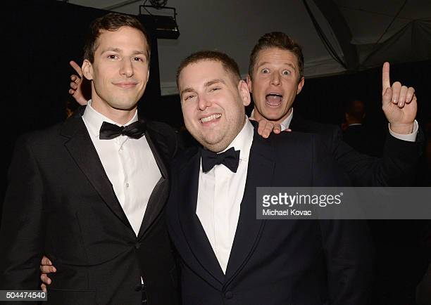 Personality Billy Bush photobombs actors Andy Samberg and Jonah Hill during The Weinstein Company's 2016 Golden Globe Awards After Party at The...