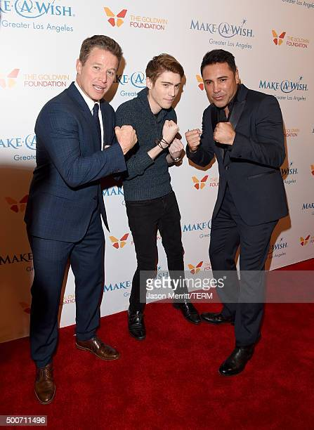 TV personality Billy Bush Travis Flores and former boxer Oscar Dela Hoya attend MakeAWish Greater Los Angeles Honoring Oscar De La Hoya Michael...