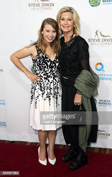TV personality Bindi Irwin and singer Olivia NewtonJohn attend the Steve Irwin Gala Dinner at JW Marriott Los Angeles at LA LIVE on May 21 2016 in...