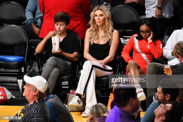 TV personality Brandi Glanville and Jake Austin Cibrian attend a basketball game between the Los Angeles Lakers and and the Minnesota Timberwolves at...
