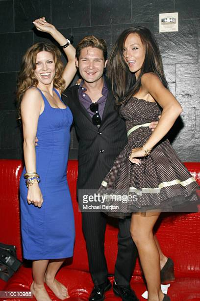 TV personality Brandi Williams Corey Feldman and wife Susie Feldman pose at the PokerStarsnet Burlesque Party at Rain Nightclub on July 7 2008 in Las...