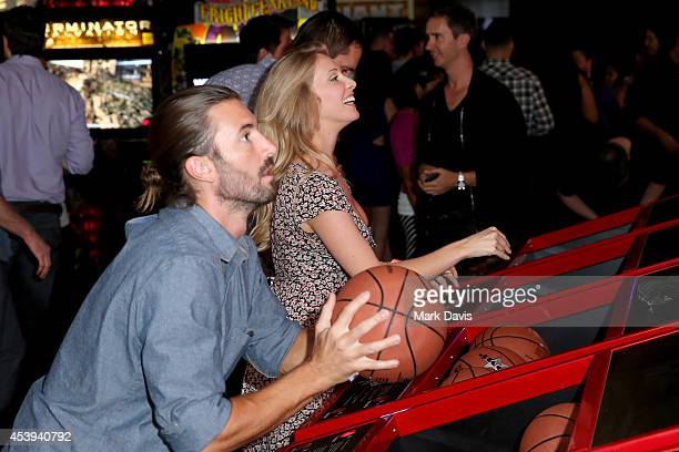 Personality Brandon Jenner and Leah Felder play arcade games at Dave & Buster's Hollywood & Highland Grand Opening on August 21, 2014 in Hollywood,...