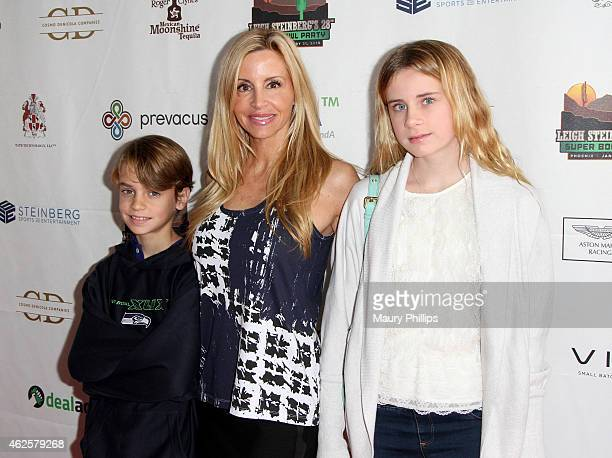 TV personality Camille Grammer with Jude Grammer and Mason Grammer attend the 28th Annual Leigh Steinberg Super Bowl Party at Arizona Science Center...