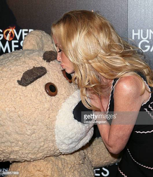 TV personality Camille Grammer with Teddy attends the premiere of Sony Pictures Home Entertainment's 'The Hungover Games' at the TCL Chinese 6...