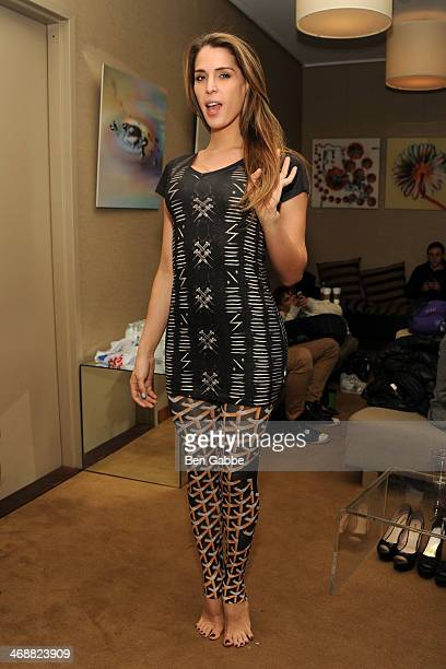 TV personality Carmen Carrera backstage during the Geoffrey Mac For Sharon Needles fashion show at Out Hotel on February 11 2014 in New York City