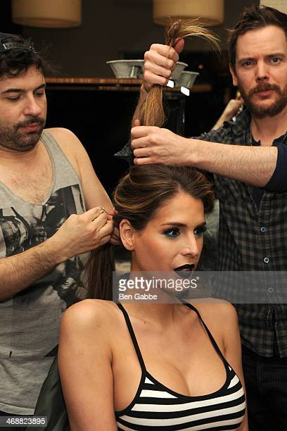 TV personality Carmen Carrera prepares backstage during the Geoffrey Mac For Sharon Needles fashion show at Out Hotel on February 11 2014 in New York...