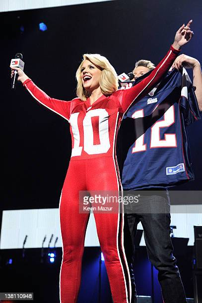 TV personality Carrie Keagan and actor Jason Dundas speak onstage during VH1's Super Bowl Fan Jam at Indiana State Fairgrounds Pepsi Coliseum on...