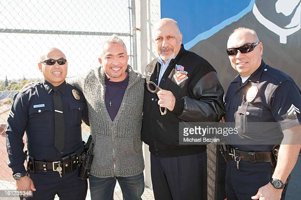 TV personality Cesar Millan and Councilman Dennis Zine with Los Angeles Police officers attend Cesar Millan and Carrie Ann Inaba team up for National...