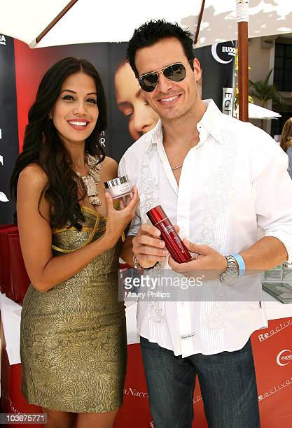TV personality Cheryl Moana Marie and actor Antonio Sabato Jr pose at Eudora International booth during Kari Feinstein Primetime Emmy Awards Style...