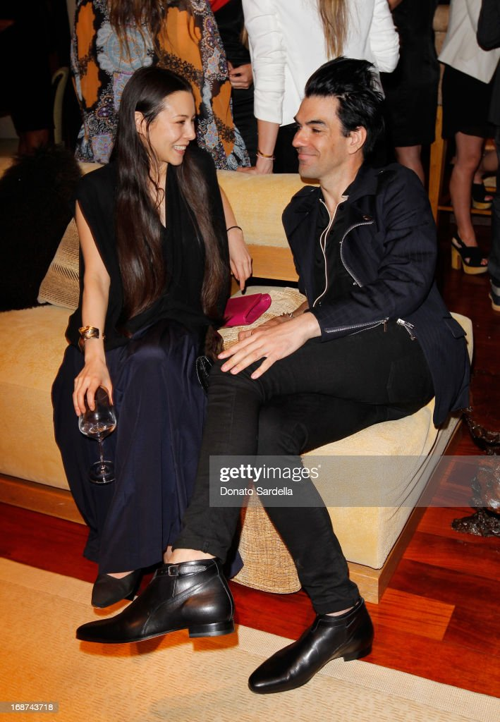 TV personality China Chow (L) and Keegan Singh attend a celebration of Jennifer Meyer's CFDA Swarovski nomination hosted by Rodarte at the residence of Joel and Karyn Silver on May 11, 2013 in Los Angeles, California.