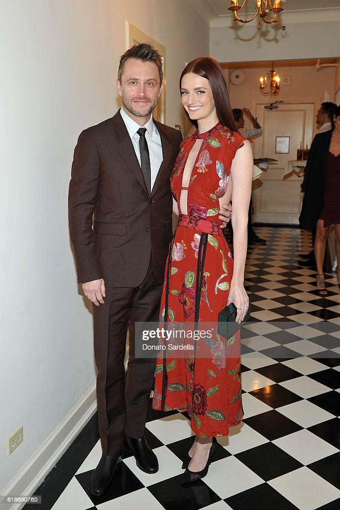 TV personality Chris Hardwick (L) and actress Lydia Hearst, wearing Burberry, attend the Vanity Fair and Burberry event celebrating Felicity Jones and the British Academy Britannia Awards at Chateau Marmont on October 27, 2016 in Los Angeles, California.