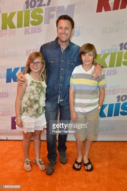 TV personality Chris Harrison Taylor Harrison and Joshua Harrison attend 1027 KIIS FM's Wango Tango 2013 held at The Home Depot Center on May 11 2013...
