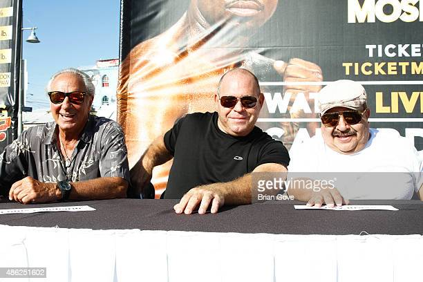 Personality Chuy Bravo and judges attend weigh-in press conference for Shane Mosley vs Ricardo Mayorga at Venice Beach on August 28, 2015 in Venice,...