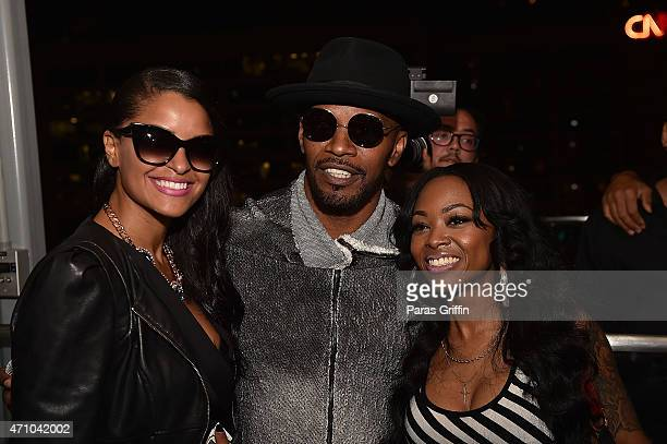 TV personality Claudia Jordan recording artist Jamie Foxx and radio personality Jazzy McBee attend the Jamie Foxx private listening session at The...