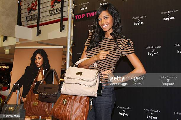 TV personality Collien UlmenFernandes presents her 'bagsac' collection at the Alexa shopping mall on October 6 2011 in Berlin Germany