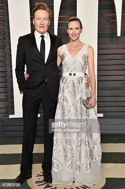 TV personality Conan O'Brien and Liza Powel attend the 2016 Vanity Fair Oscar Party Hosted By Graydon Carter at the Wallis Annenberg Center for the...