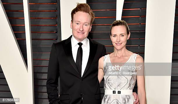 TV personality Conan O'Brien and Liza Powel attend the 2016 Vanity Fair Oscar Party hosted By Graydon Carter at Wallis Annenberg Center for the...