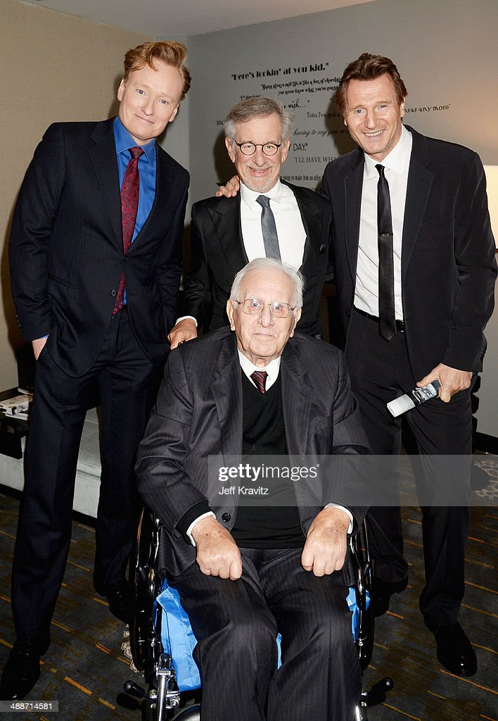 TV personality Conan O'Brien, USC Shoah Foundation Honorary Chair Steven Spielberg with father Arnold Spielberg (seated), and actor Liam Neeson attend USC Shoah Foundation's 20th Anniversary Gala at the Hyatt Regency Century Plaza on May 7, 2014 in Century City, California.