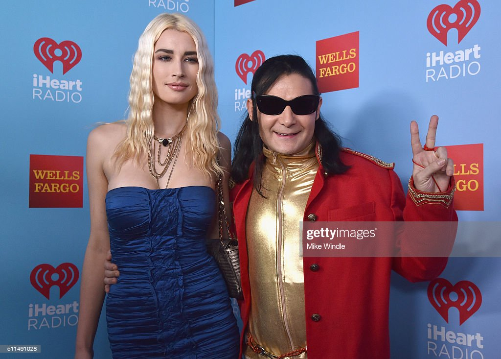 TV personality Courtney Anne Mitchell (L) and actor Corey Feldman pose backstage during the first ever iHeart80s Party at The Forum on February 20, 2016 in Inglewood, California.